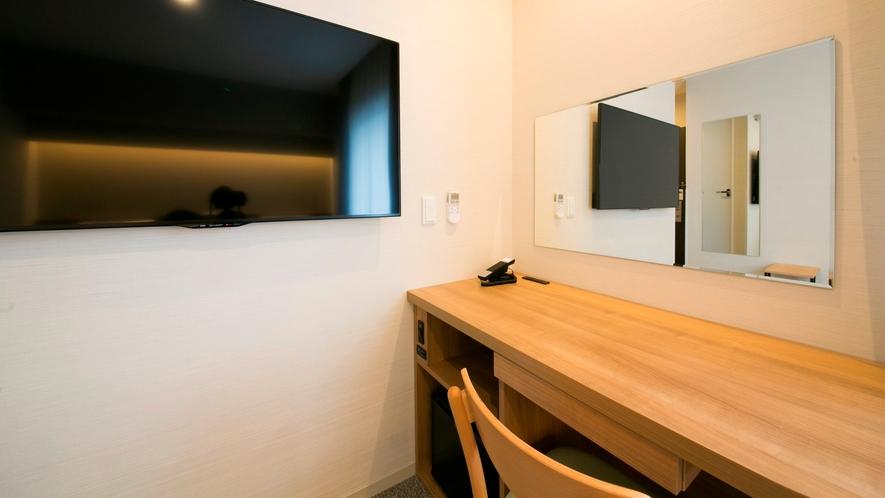 大画面50インチ壁掛けテレビを全室導入