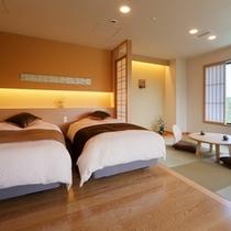 特別室月物語『嘉月』ベッドルーム。寝具はシモンズ社のベッドとエアウィーヴ社のマットレスパッドを使用。