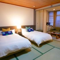 【東館ツインベッドルーム(一例)】シックで落ち着いたお部屋です