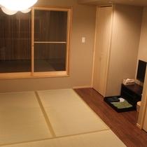 さと居 香雪 客室 2階寝室 2つのベットと寝具となります。