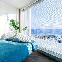 *部屋一例/角部屋では大きな窓から沖縄・読谷の景色を一望できます。