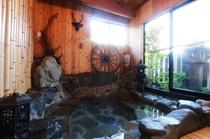 「ボタンの間」の岩風呂