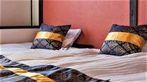 丸八真綿グループの株式会社ハッチ様のお布団で旅の疲れを癒してくれる寝室