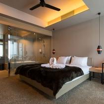 *3ベッドルームミハラシデラックス室内一例/ツインまたはダブルベッドの寝室。