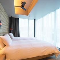 *3ベッドルームヌプリデラックス室内一例/ツインまたはダブルベッドの寝室。