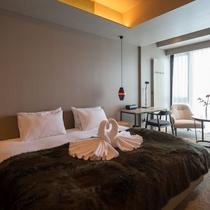 *3ベッドルームミハラシプレミアム室内一例/ツインまたはダブルベッドの寝室。