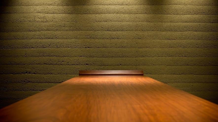 日本を代表する左官職人として国内外で活躍し続ける久住有生氏による土壁が印象的なロビー