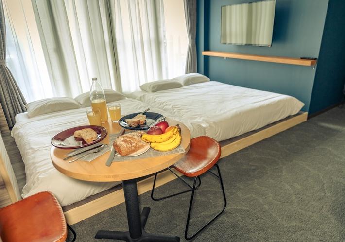 スーペリアクアッドルーム  ベッド