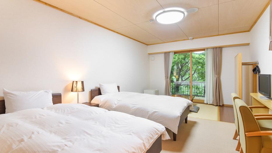 *【モダンルーム一例】ツインベッド+畳スペースがあるお部屋です。