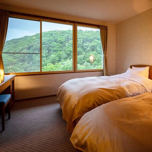■和洋室ツイン■1人1つのベッドで広々とリラックスしてお使いいただけます