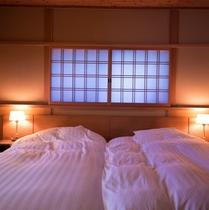 客室「ゆずり葉」ベッド