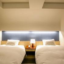 【デラックスツイン】アーチを描く天井が特徴的なお部屋