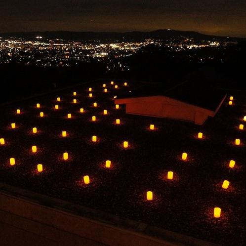 ロウソクの灯りと夜景