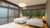 【スタンダード・106】 グレーと木の色を基調とした落ち着いた内装のお部屋です。