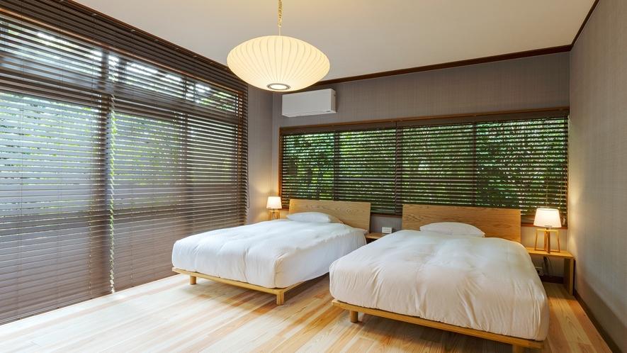 【VMGグランド・106】 グレーと木の色を基調とした落ち着いた内装のお部屋です。