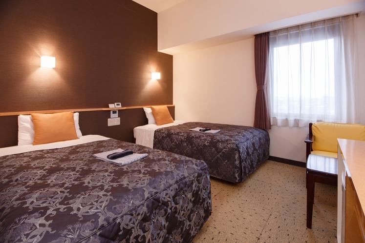 <ツインルームA>グループ、団体のご旅行、ファミリーでご利用いただけるお部屋です。