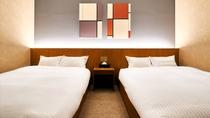 ・最上階スイート/ツインベッドタイプの寝室