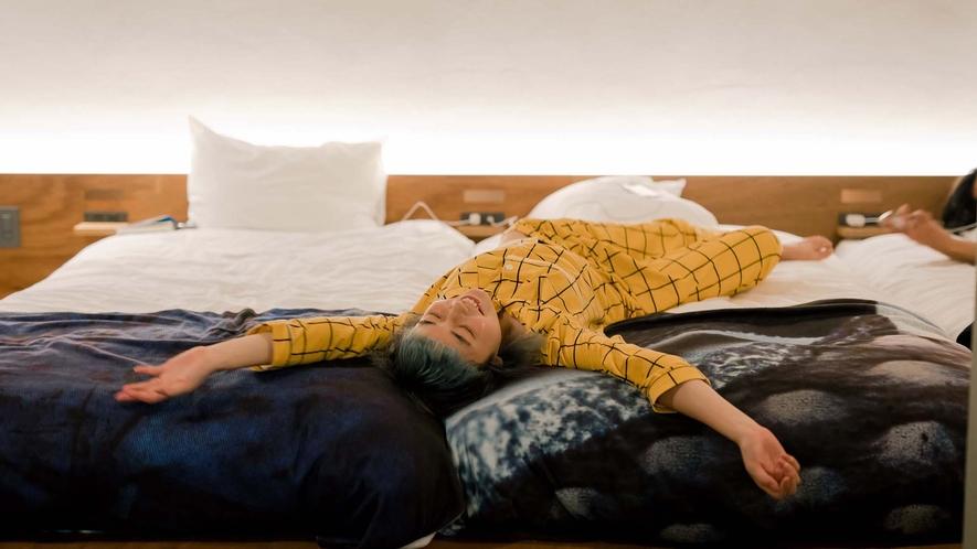 ・スーペリアルームの心地よいベッド