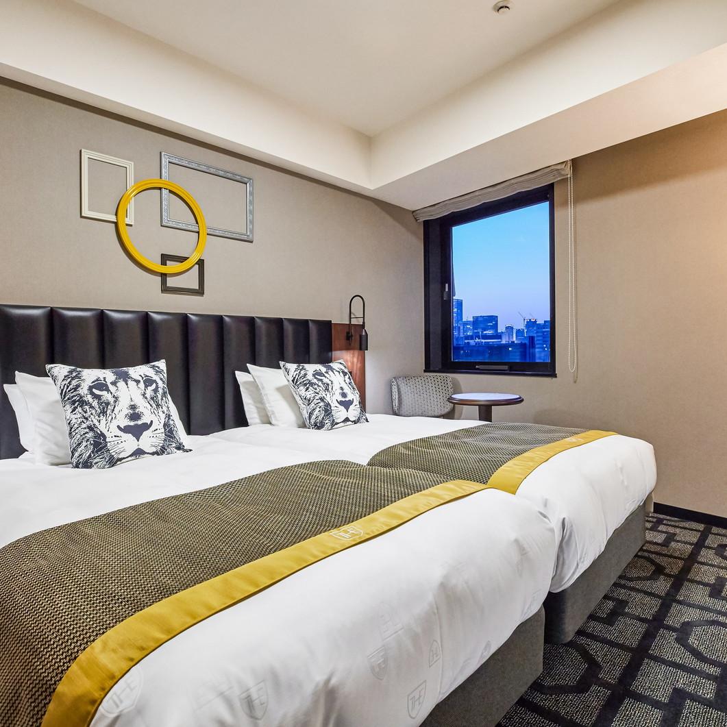 【スーペリアツインルーム】24.4〜26.1m2。バスタブ付、ベッド2台で快適なご滞在を実現。