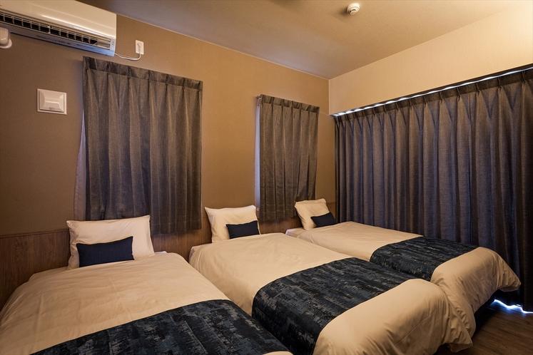 かりゆしコンドミニアムリゾート北谷ルート58 独立したトリプルベッドルーム(シーリー社製)