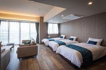 リビングダイニングの3台のベッド(シーリー社製プレミアムベッド)