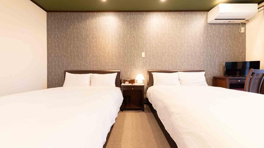 ・【1階】ベッドルームはダブルベッドを2台ご用意いたしております
