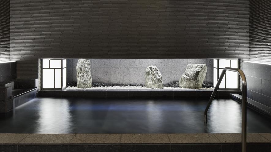 黒御影石で構成された静かで落ち着きのある大浴場