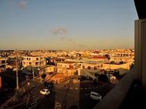 ブラウンシュガーからの望む夕日に染まる街並み