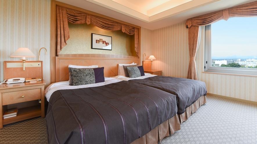 **【部屋(コーナーツイン)】ベッドは2台を隙間なく並べた、ハリウッドスタイル