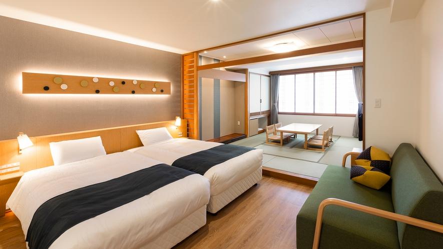 【スタンダード和洋室】客室のベッドはハリウッドツインタイプを採用しております。