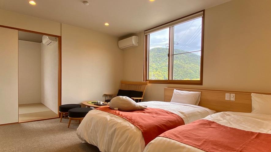 【特別室】セミダブルのシモンズ製のベッドでお寛ぎください