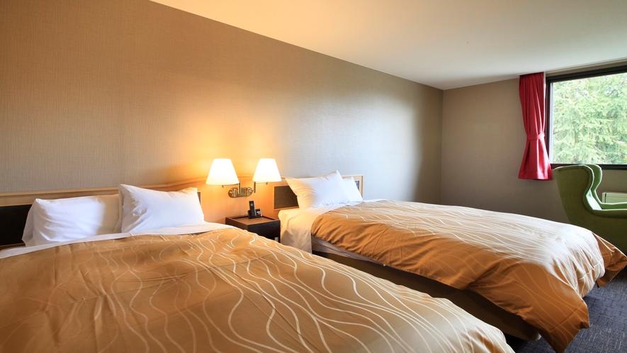 ■「デラックスツイン」シモンズ製のベッドを使用しています。