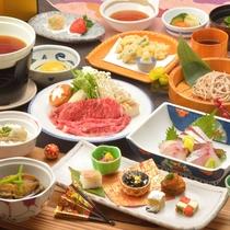 ご夕食の一例(飛騨牛のすき焼き、鮑やわらか煮、地魚含むお造り盛合せなど)