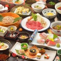 ご夕食の一例(飛騨牛のすき焼き、鮑やわらか煮、金目鯛を含むお造り盛合せなど)