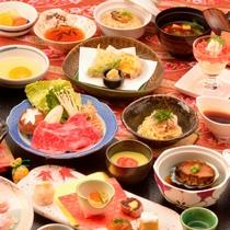 ご夕食の一例(地魚などのお造り盛合せ、飛騨牛のすき焼き、鮑柔らか煮など)