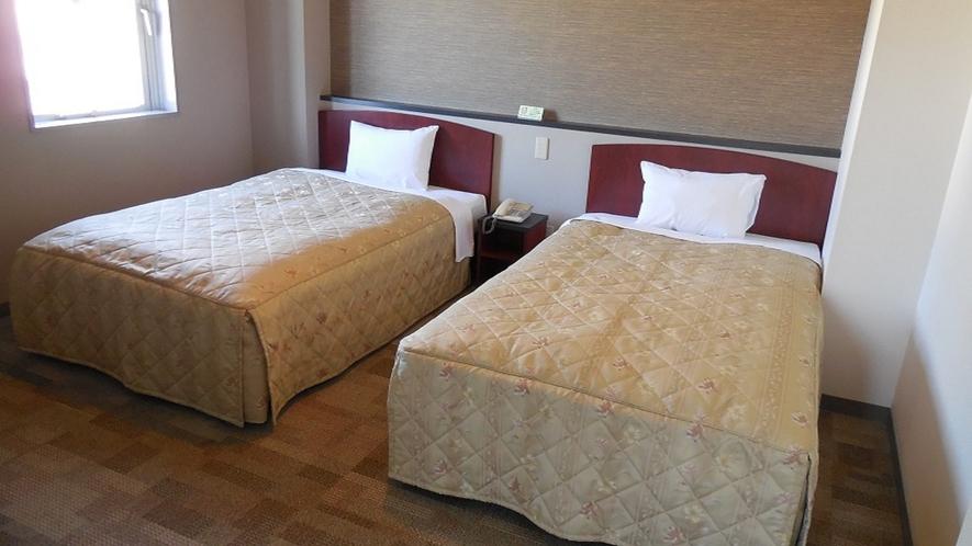 デラックスツインルーム(ベッド側)