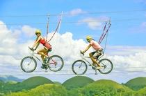 つがいけWOW 空中自転車綱渡り「コギダス」