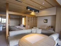 【露天風呂付:和モダン洋室260号室】明るい光が差し込むリビングダイニングに落ち着いたベッドルーム