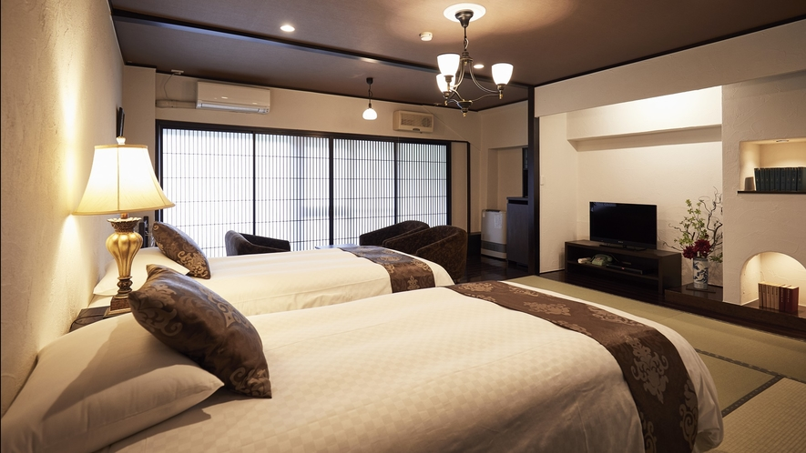 山月亭・ベッド◆蓼科の自然と渓流を臨むリビングも備えた広めのお部屋