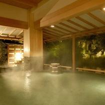 ゆったり寛げる薬師の湯大浴場『水心鏡』の満月風呂(夜)