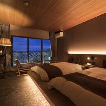 ・【洋室】ベッドルームからも日本庭園「松濤園」を臨むことができます。