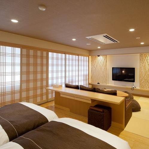 【特別室】くつろぎスペースには50インチのテレビと大型ソファを備えます。