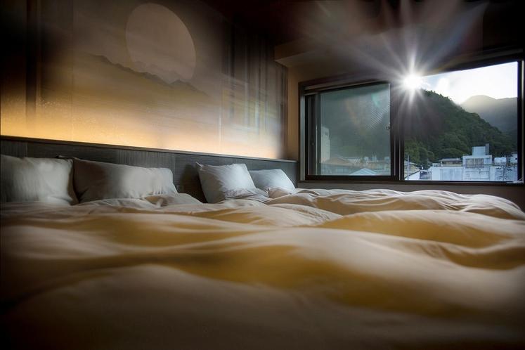 セミスイート游 ベッドはダブルコイルの贅沢な寝ごこち