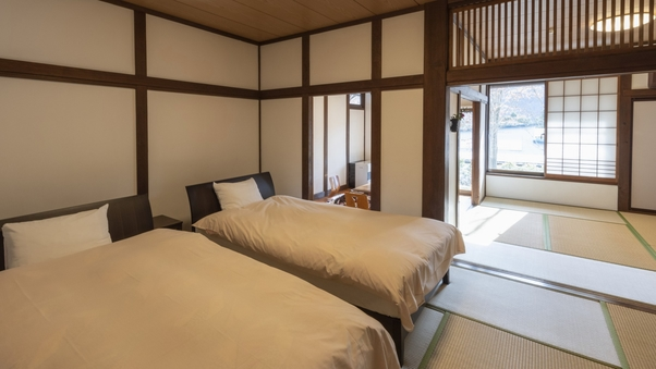 和洋室22畳三間続き(43平米)ツインベッド+堀ごたつ付