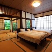 和洋室22畳三間 - 快適ベッドでいつでも寝ることができるのでごゆっくりお寛ぎいただけます。