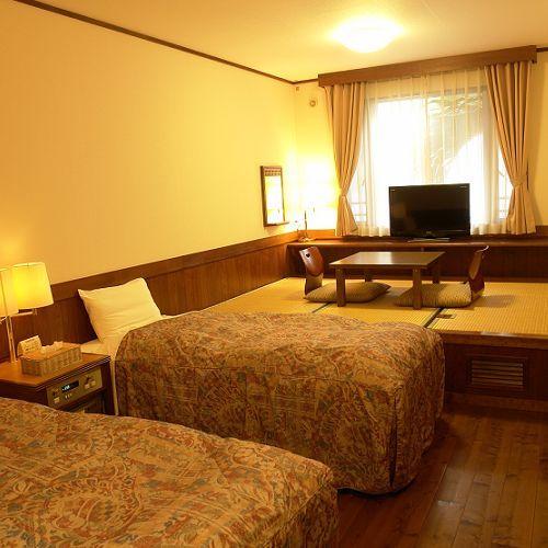 和洋室C(ツインベッド+3畳)21平米(12畳)