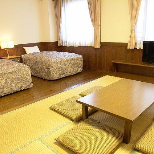 和洋室A(ツインベッド+畳間6畳)31平米(19畳)