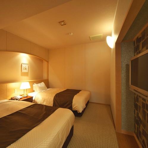 ジェットバスの露天風呂付き&ベッドルームのベッドルームの画像
