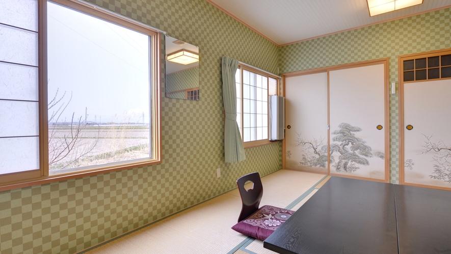 *和室8〜10畳(客室一例)/大きな窓からはどこまでも続く広い津軽平野を一望。