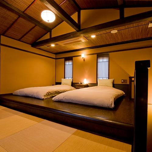 【雪type】2階にはツインのローベッドを配したベッドルームをご用意しています